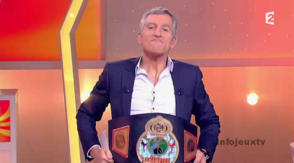 Nagui avec la ceinture de Champion du monde